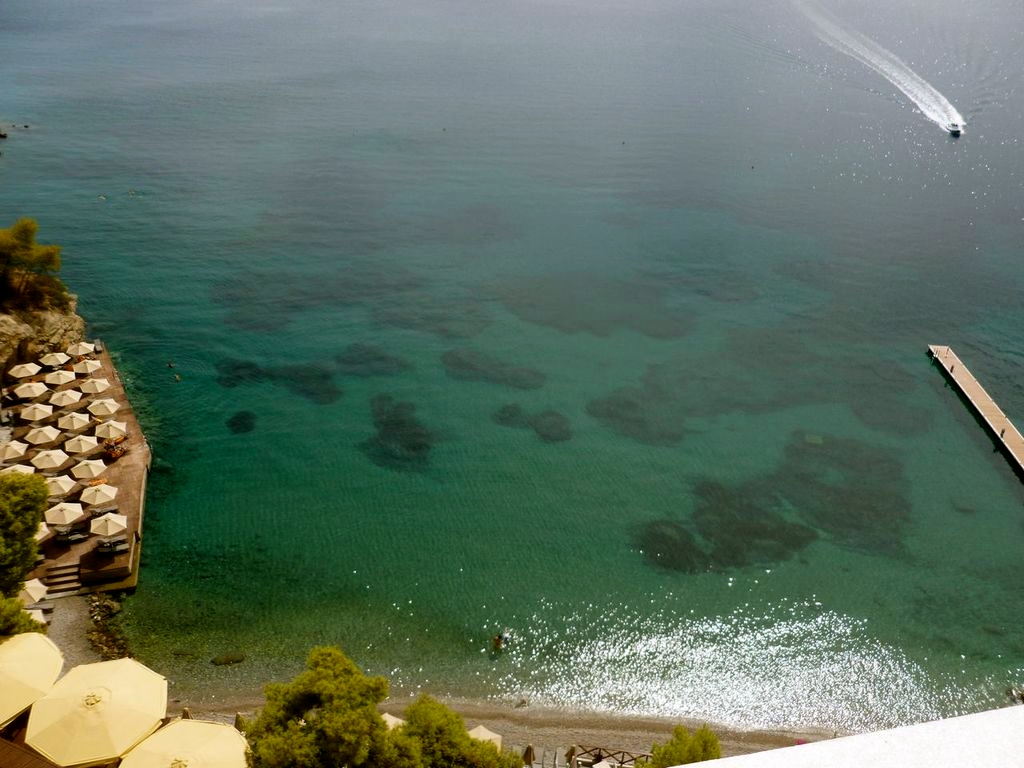 Cliff-top hotel with a lift down to a fantastic beachside restaurant for lunch on Poros